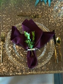wine and gold place setting